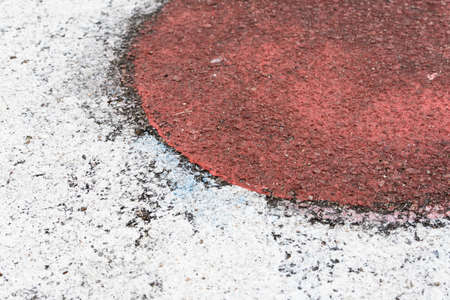 Japan flag painted on the asphalt in the country's colors. Alphast texture and paint colors.