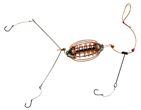 bait ball: Feeder for fishing and fishing line with hooks isolated Stock Photo