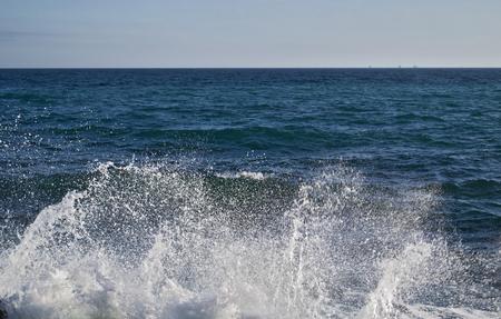 powerful: Powerful Waves crushing on a rocky beach