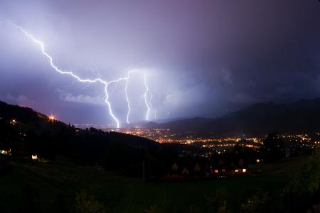 Night storm near Zakopane in Tatra Mountains, Poland. Reklamní fotografie - 90409363