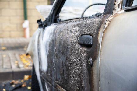 Closeup of the car burnt down on the city car park