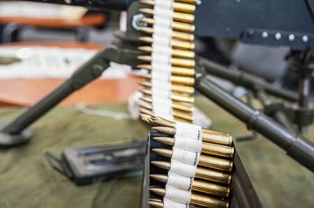 Closeup of loaded machine gun with ammunition belt