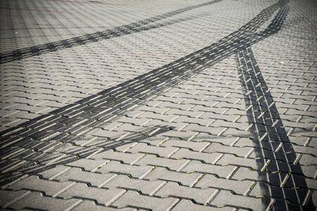 Black tire tracks on the pavement after drifting Stock fotó
