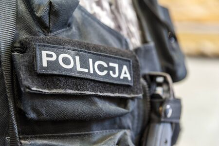 POLICJA inscription on the polish police uniform