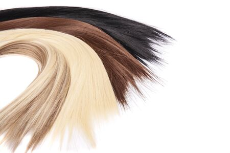 Long hair extensions in natural colors. Black, brown, blonde, and blonde balayage.