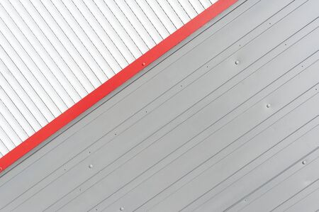 Abstract view of white, red nad grey anti-theft shutters