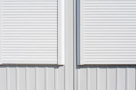 Abstract view of white anti-theft shutters Banque d'images