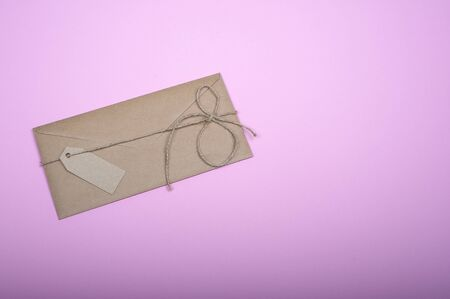 Closeup of the handcrafted envelope made with brown wastepaper