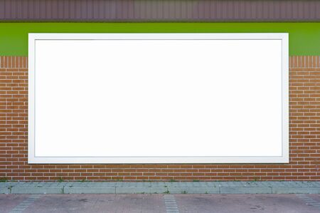 Blank billboard mounted on the brick wall. Stock Photo