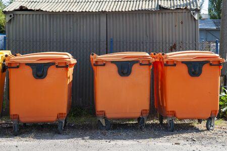 Row of orange garbage bins for sorted waste Standard-Bild