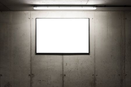 Blank white banner for advertisement on the wall of underground car park