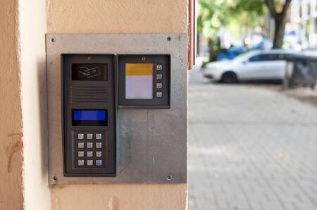 Modern digital intercom with numeric keypad and passcard sensor