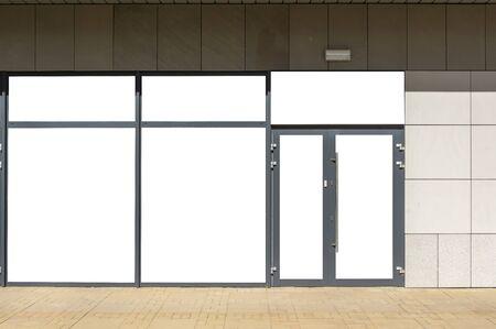 Front view of a store exterior with blank white windows. Mock up for advertisement Stock Photo