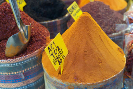 Spices at the Egyptian Bazaar, Istanbul, Turkey; translation front sign: aci toz biberi - hot ground pepper 20 TL (Turkish Lira); translation rear sign: sumak - sumac