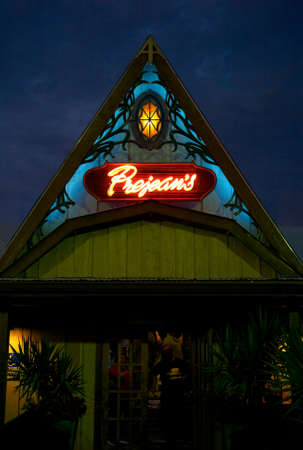 Lafayette, Louisiana, USA - July 16 2009: The illuminated entrance to the famous Louisiana cajun restaurant Prejeans in Lafayette at dusk. Editorial