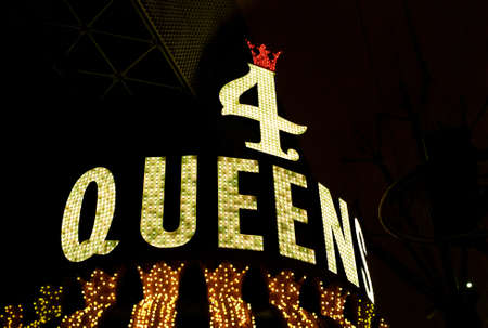 Las Vegas, Nevada - July 06 2009: The Golden neon sign illuminated above the entrance of the Four Queens Casino in the world famous Freemont Street.