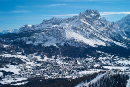 The Romantic, Snow Covered Skiing Resort of Cortina d Ampezzo in the Italian Dolomites seen from Tofana with Col Druscie in the foreground.