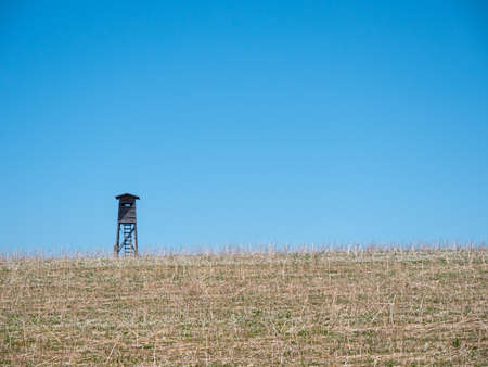 A Hunting Perch or High Seat in a Field with Dry Grass in a Lonely Rural Area in Austria