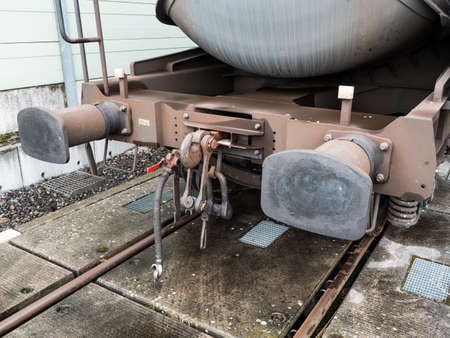 Buffers and Chain Coupler on a Standard Gauge Railway Wagon Painted Brown