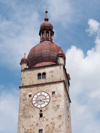 City Tower of Waidhofen an der Ybbs, called Stadtturm in German, with Stone Facade, Red Roof, Clock and Blue Sky