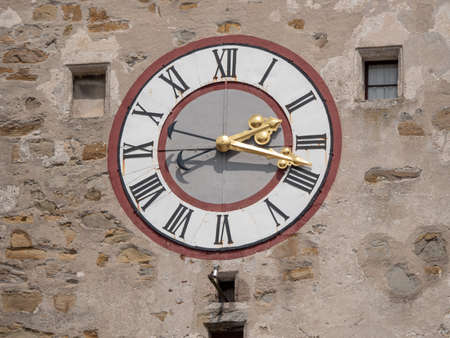 Old Clock on the City Tower of Waidhofen an der Ybbs with Ornate Golden Hands and Roman Numbers Stock Photo