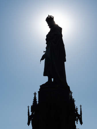Silhouette of Statue of Charles IV near Charles Bridge in Prague against the sun. Monument made by Arnost Hahnel in 1848. Stock Photo