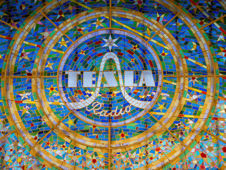 Prague, Czech Republic - June 8 2019: Tesla Radio Logo on a colorful stained glass window in the Svetozor Passage in Prague.