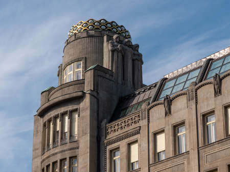 Prague, Czech Republic - June 9 2019: Koruna Palace Building on Saint Wenceslas Square. A famous Art Nouveau Building by architect Antonin Pfeiffer with statues by Stanislav Sucharda built in 1914.