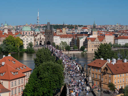 Prague, Czech Republic - June 8 2019: Charles Bridge across River Vltava in Prague Crowded with Tourists on a Summer Day, Aerial View