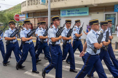 Marigot, Saint-Martin, France - July 14, 2013: French police officers taking part in the parade on the 14th of july, the french national holiday in Marigot, Saint Martin. Editorial