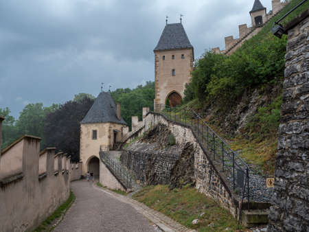 Karlstejn, Czech Republic - June 22 2019: Entrance to Gothic Karlstejn Castle with First Gate and Vorsilska Tower and Battlements