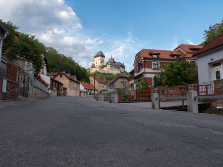 Karlstejn, Czech Republic - June 21 2019: Medieval and gothic Karlstejn Castle Towering over the Village in Bohemia, Czech Republic in Golden Evening Light Editorial