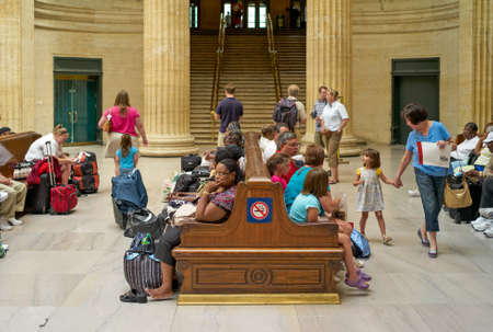 Chicago, Illinois, USA - July 25 2009: Travellers Waiting on Benches Inside Chicago Union Station, with Staircase in Background. Editorial