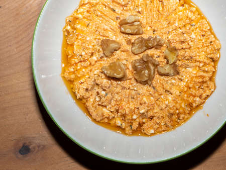 Turkish Meze Feta Sheep Cheese and Walnut Spread - Oriental Appetizer in a Bowl on a Wooden Table - Beyaz Peynir Ezmesi 写真素材 - 129686754