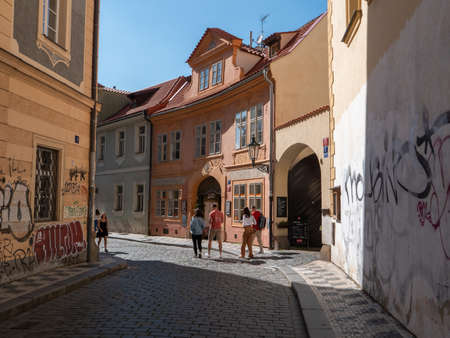 Prague, Czech Republic - June 8 2019: Lesser Town of Prague Street Scene with Tourists and Old Buildings, Tri Stoleti Cafe and Restaurant and Cobblestones Editorial
