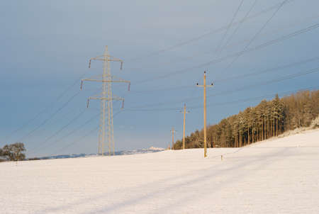 Electric Powerlines Crossing in a Winter Landscape - 20kV - Powerline crossing under a 380kV - Powerline - A Concept for the Transmission of Electic Energy Stock fotó