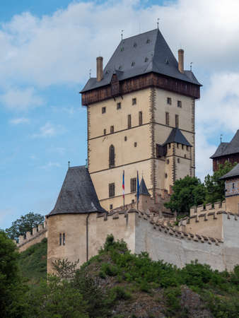 The Big Tower of Gothic Karlstejn Castle in Bohemia Czech Republic, a Medieval Fortress buildt by Holy Roman Emperor and Czech King Charles IV in Central Europe on a Sunny Summer Day.