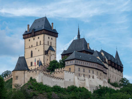 Gothic Karlstejn Castle in Bohemia Czech Republic, a Medieval Fortress buildt by Charles IV in Central Europe on a Sunny Summer Day.