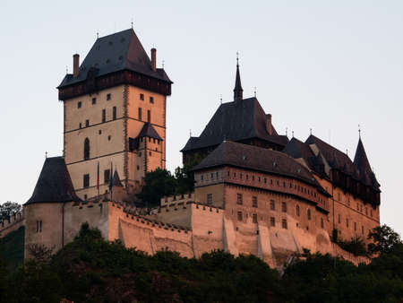 Gothic Karlstejn Castle at Sunset in Bohemia Czech Republic, a Medieval Fortress buildt by Charles IV ind Central Europe