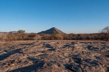 Etendero Mountain in Erongo Region, Namibia in Golden Evening Light with Arid African Bush Landscape