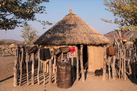 Traditional Tribal Hut of a Himba Chief, with Clay Walls and Straw Thatched Roof in Kaokoveld, Namibia