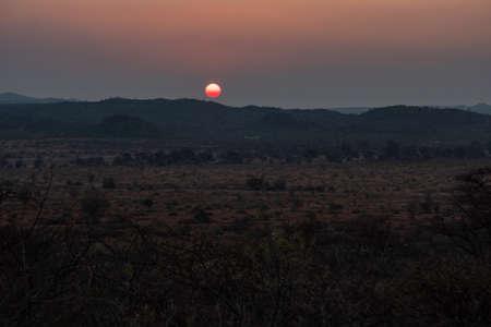 Romantic Sunset in the Bush of the Kalahari Savanna, Namibia, Africa. Wilderness Landscape at Dusk. Zdjęcie Seryjne