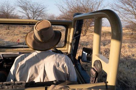Guide Driving Off-Road, All-Terrain 4WD Vehicle through the African Bush in Makgadikgadi Salt Pan, Botswana, Africa