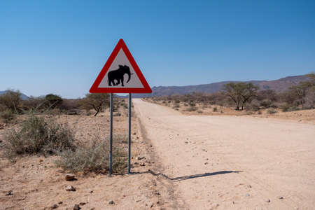 Elephant Crossing Road Warning Sign in Namibia, Triangle Shape, Danger of Animal Collisions Attention Sign