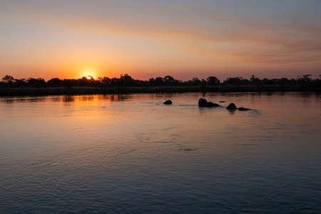 Romantic Sunset on the Okavango River, Caprivi Strip, Namibia, Africa - Beautiful, Serene, Lonely Landscape Zdjęcie Seryjne