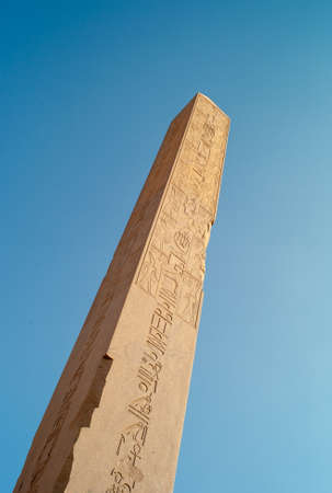 Obelisk of Queen Hatshepsut in Karnak Temple, a Granite Needle Monolith in Luxor, Egypt, Isolated on Blue Sky Zdjęcie Seryjne