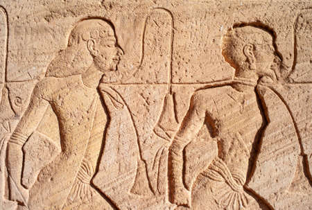 Abu Simbel - Stone Relief Detail depicting Slaves on the Great Temple of Ramesses II in Egypt
