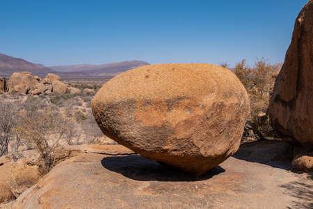 Orange Balancing Rock in the Erongo Mountains, Namibia - Dry African Landscape