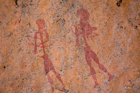 Primitive Ancient Bushman Rock Painting Art - Two Hunters or Warriors with Bow and Arrow Painted by the San Tribe in Red on Orange Rock