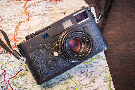 Travel Photography Concept - Vintage Photo Camera and Map